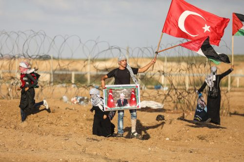 The Turkish flag and pictures of Erdogan waved during the Gaza rioting