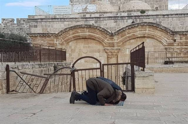 Muslims pray outside of the Mercy Gate.