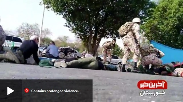 Iranian soldiers in the Ahwaz parade taking cover during the attack