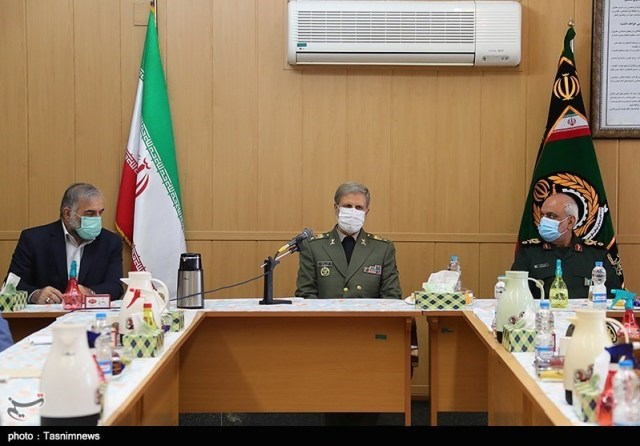 Mohsen Fakhrizadeh in a meeting with the Minister of Defense, General Amir Hatami