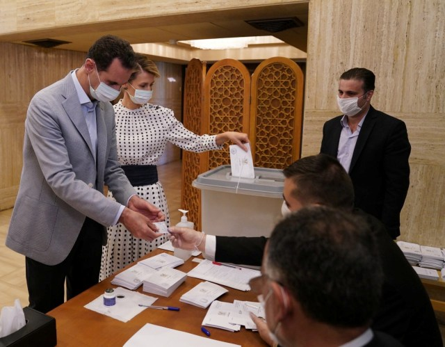 Syrian President Bashar al-Assad and his wife, Asma, casting their votes in parliamentary elections in July 2020