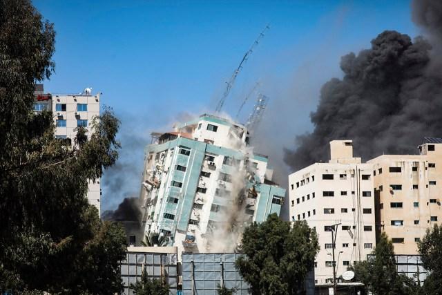An Israeli airstrike destroys a high-rise building in Gaza City