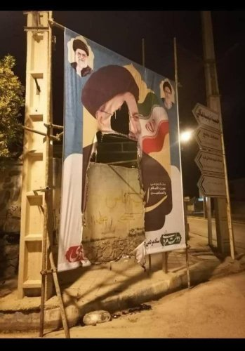 A Raisi campaign poster shredded in the Bushehr province of Iran
