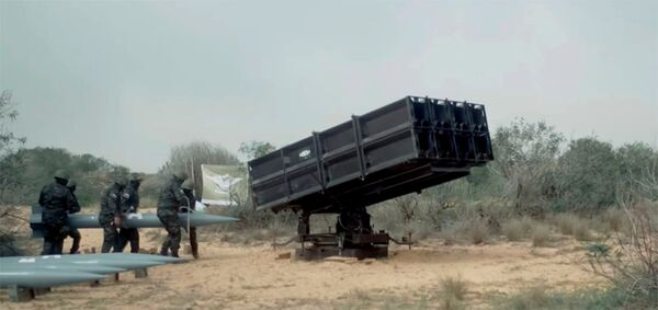 Loading of A-120 rockets into a multiple rocket launcher