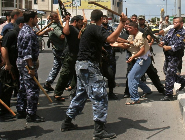 Hamas police confront Fatah members who tried to pray in the open in one of Gaza's squares in 2007.