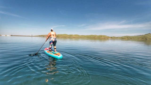 standing on paddle board