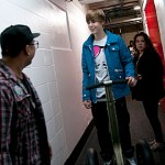 Legaci member Micah Tolentino chatting with Justin Bieber backstage at the Saddledome in Calgary