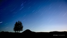 A free downloadable wallpaper image of long exposure star trails