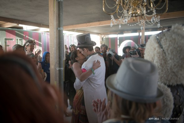 The happy couple's first kiss. Magical things happen at Burning Man.