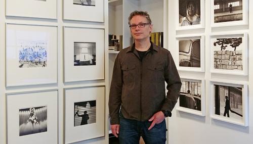 Dick Bakker in front of his prints.