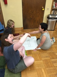 Leora, Sarah, and Abby creating their root cause tree during our systemic oppression workshop with Jessica Havens