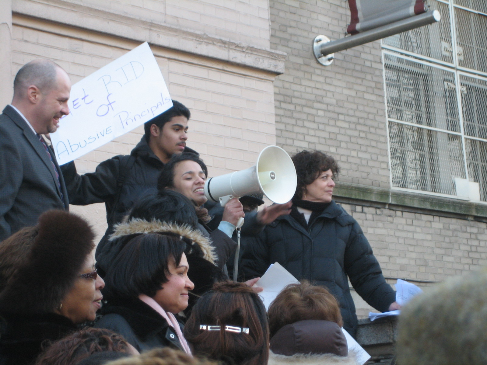 Fordham HS for the Arts teacher addresses the gathered throng