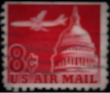 plane over hill stamp