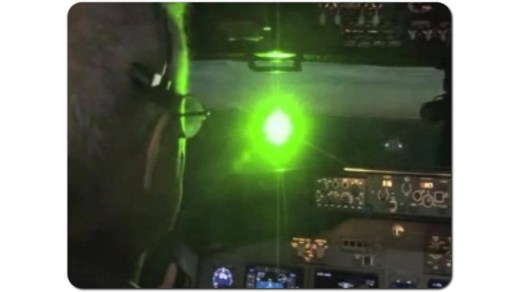 LASER LIGHT HITTING AIRCRAFT