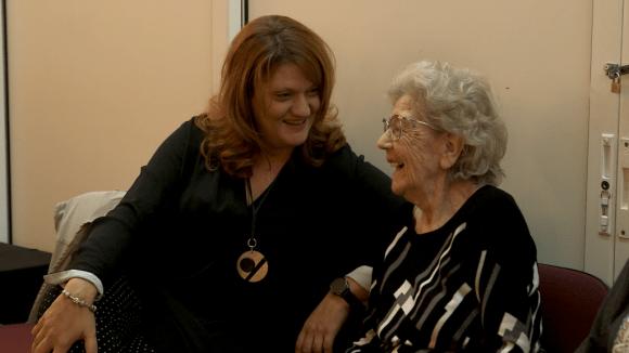 Julia Dandolova laughs with an elderly community member.