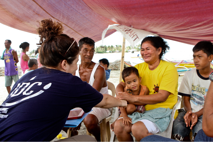JDC humanitarian aid worker in the Phillipines meeting with family in the aftermath of Typhoon Haiyan.