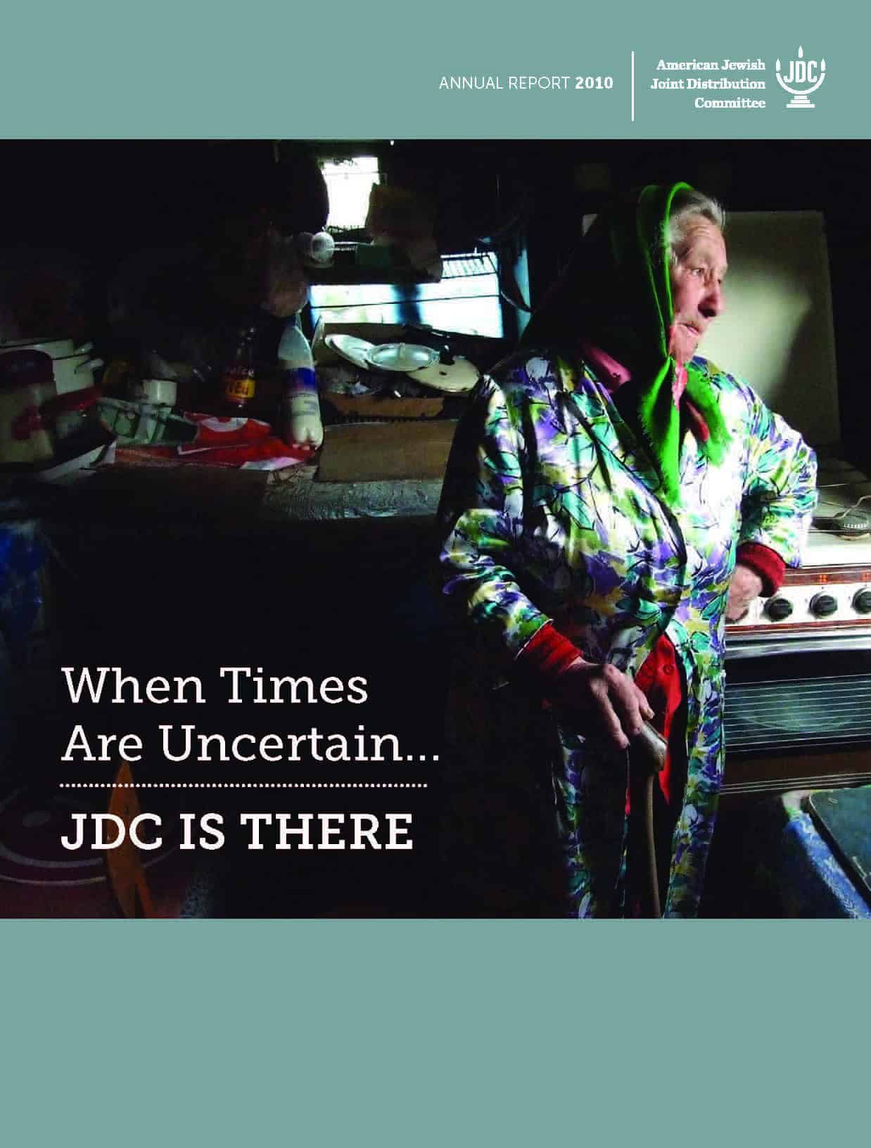 JDC's Annual Report 2011 showing an elderly JDC client in the former Soviet Union standing in her kitchen.
