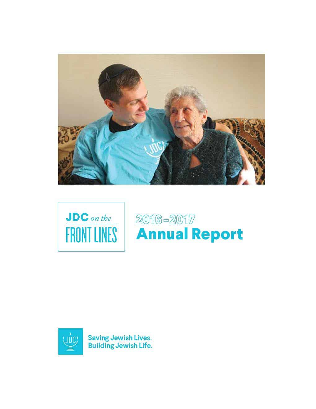 JDC's Annual Report 2017 in which a JDC homecare worker in the former Soviet Union embraces an elderly client on her couch.