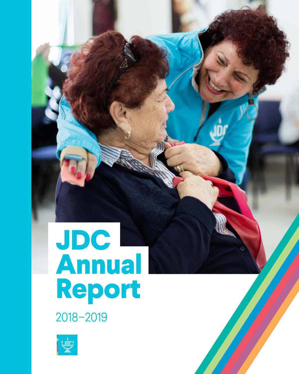JDC's Annual Report 2019 in which a JDC volunteer in Israel embraces an elderly client and smiles.