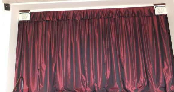 Zanzibar front of house curtain with matching valance in village hall