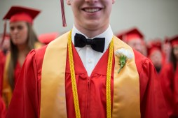 Matt Dunham smiles for a portrait before the Red River's high school graduation ceremony at the Alerus Center in Grand Forks, ND