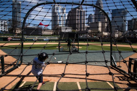 Kit Noblett, 10, hits a ball at a season ticket holders event for Charlotte Knights season-ticket holders at BB&T ballpark