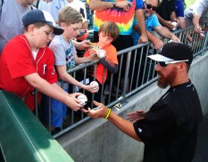 From left, Laden Hershberger, 9, Daniel Blackwood, and Jacob Bennett, 9, get signatures from Whites Sox Adam LaRoche at the BB&T BallPark in Charlotte, NC on April 3, 2015.