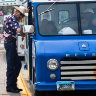 walter Butzer talks to a food truck owner in downtown Grand Forks, ND on July 4, 2015. (Grand Forks herald/ Joshua Komer)