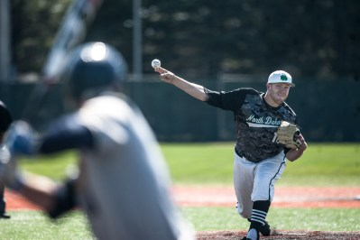 UND's Brett DeGagne' fires a pitch against Northern Colorado's Marco Castilla, left, during the second inning of the game at Kraft Field in Grand Forks, ND on Saturday, April 30, 2016. (Joshua Komer/Grand Forks Herald)