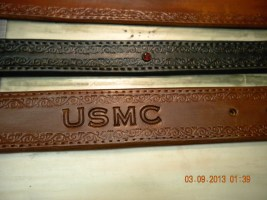 "A look at a 1.5"" Canyon Tan belt for a marine and a 1"" Coal Black belt with some red bling for a young lady."