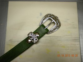 "A 1"" forest green lady's belt with the Tandy Celtic buckle (Tandy Item #7809-05)."