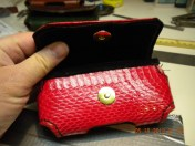Snakeskin covered smart phone case with hidden magnetic case latch -- open