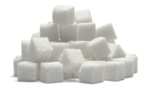 Lots of white sugar cubes laid on a blank background