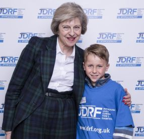 Home Secretary Theresa May with JDRF supporter James Vickers
