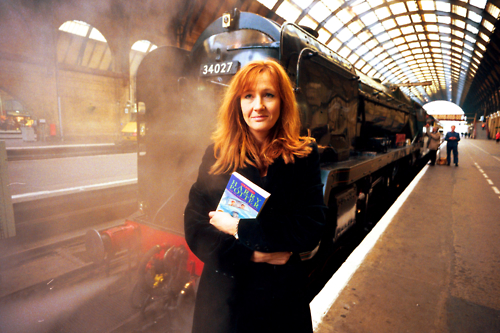 j.k. rowling in front of a train