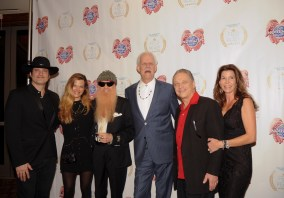Robert Rodriguez (L), Gilligan Gibbons, Billy Gibbons, Turk Pipkin, Jimmie Vaughan and Robin Vaughan pose on the red carpet during the 10th Annual Nobelity Project Feed The Peace Awards at the Four Seasons Hotel on February 15, 2015 in Austin, Texas.