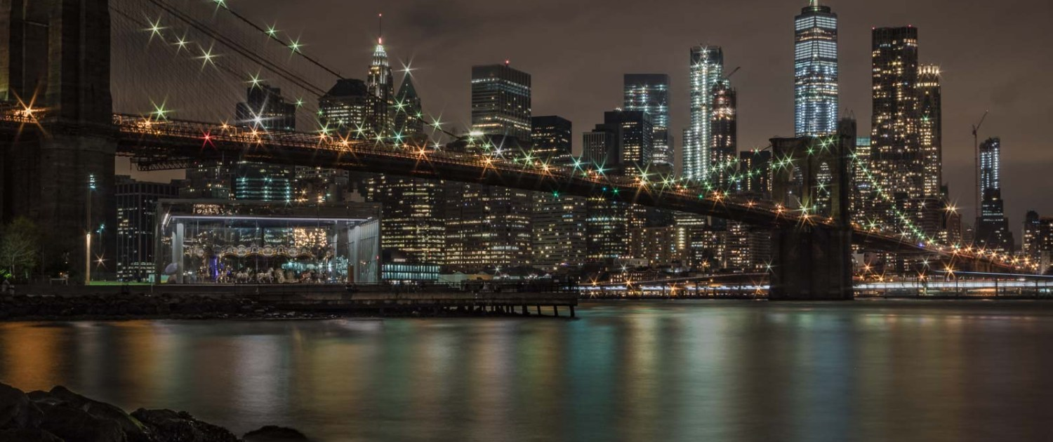 A night Picture of New York City Financial District Skyline and the Brooklyn Bridge. [Photo by Dominique St-Germain]