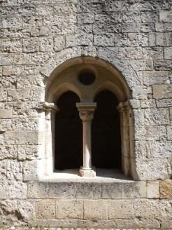 Fenêtre à arcade géminée et oculus unique