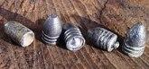 Différents types de balles Minié. Les quatre de droite ont les rainures Tamisier pour améliorer la précision du tir
