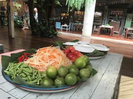 ingredients - papaya, carrot, lentil plant, lime, tomato...