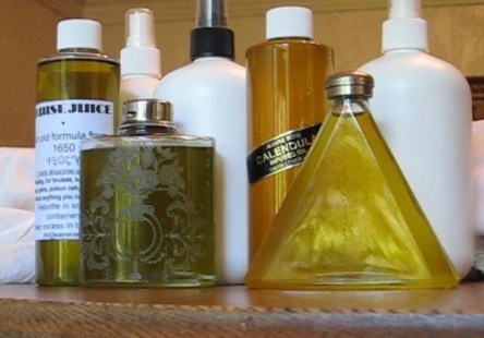 photo of various bottles that contain either Brise Juice or Calendula infused joil