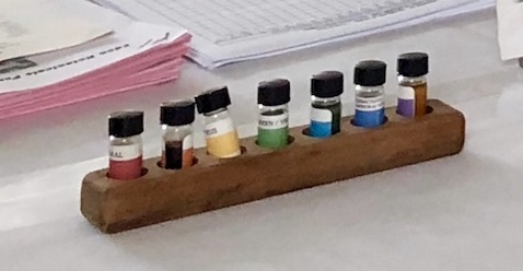 7 bottles showing the Basic 7 Vocabulary of Odor and their colors as it relates to the Chakra and Spectrum