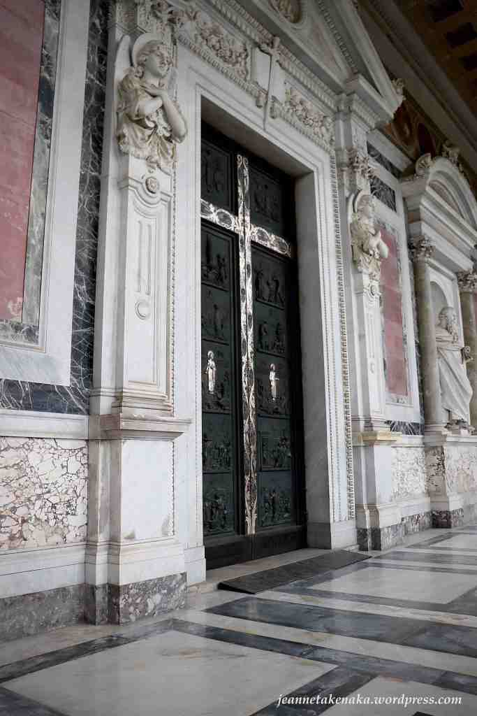 An image of a large silver cross etched into a black doorway (St Paul's Cathedral, Rome) . . . a reminder that before the resurrection came the crucifixion, but Jesus' resurrection is an open door into relationship with God.