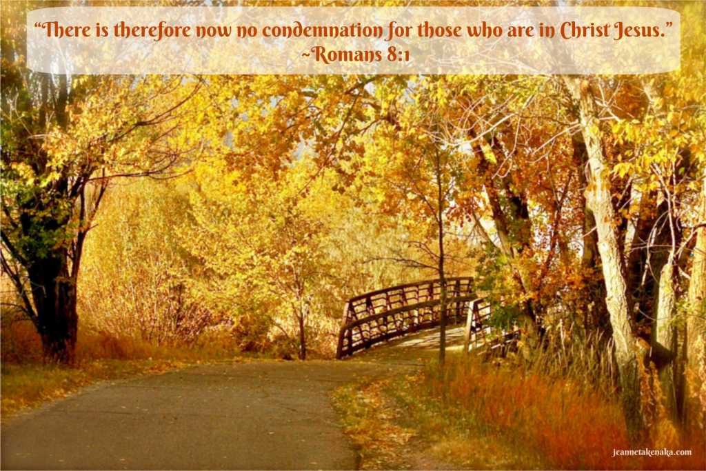 "A meme with the words, ""There is therefor now no condemnation for those who are in Christ Jesus."" ~Romans 8:1 on a backdrop of fall foliage surrounding a bridge"