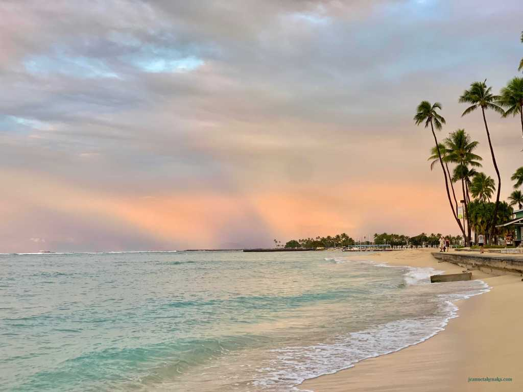 A pastel beach sunrise
