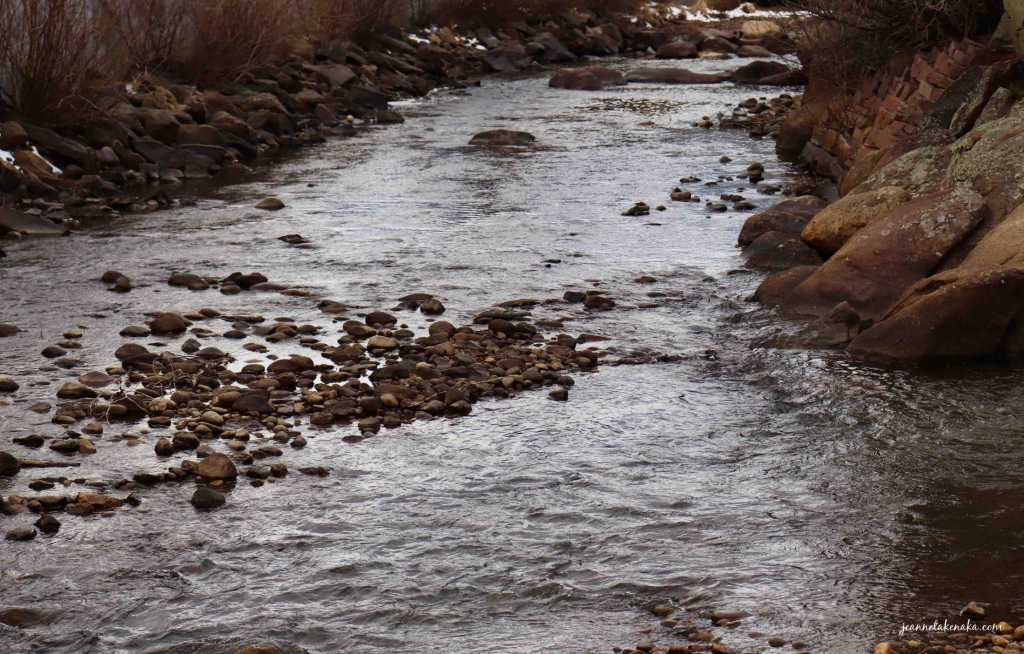 A river running between rocky shorelines...a visual for how we can become busy and distance ourselves when God feels distant