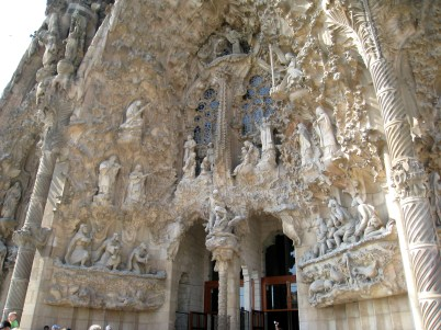 This facade shows important scenes featuring the titular Holy Family (Jesus, Mary, and Joseph) in ornate detail with many images of nature