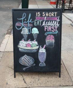 A dessert-first sandwich board outside Fezziwegs Ice Cream, Philadelphia