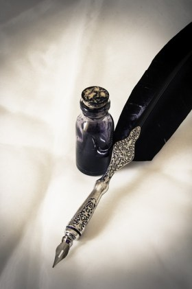 A fancy quill pen and ink pot for Justin Edison's Launch daily affirmation.