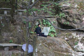Korea Północna - malarz przy pracy